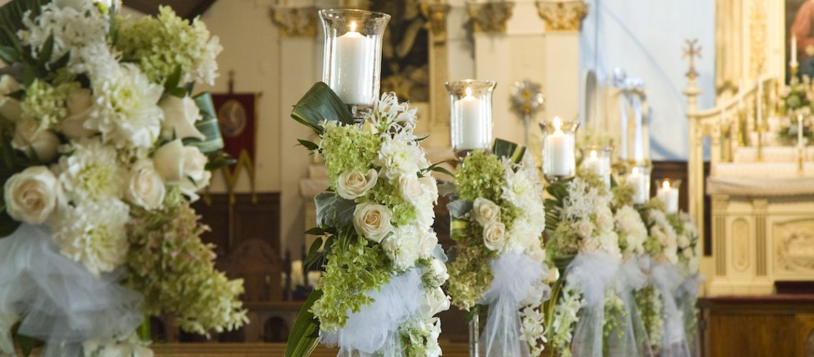 White orchids and roses with greens at a church weddingWhite orchids and roses with greens at a church wedding